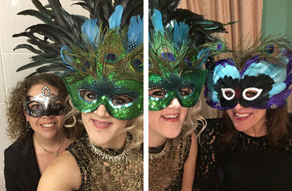 Two women with ornate feathered masks